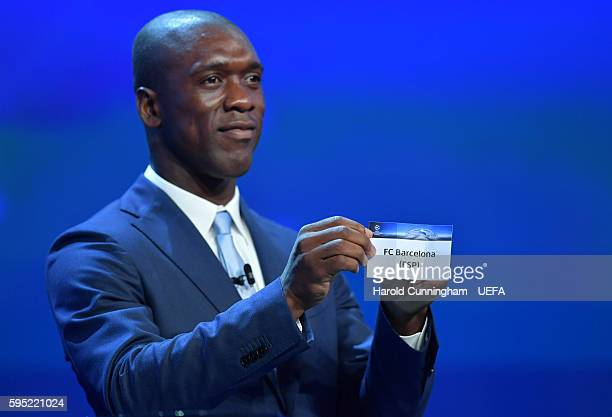 Special guest Clarence Seedorf draws out the name of FC Barcelona during the UEFA Champions League draw part of the ECF Season Kick Off 2016/17 on...