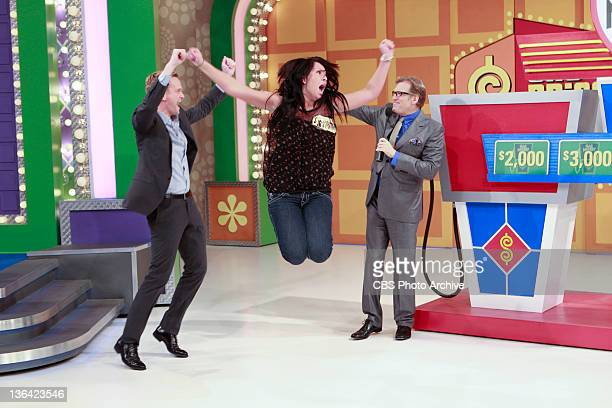 Special guest Neil Patrick Harris jumps for joy with contestant Samantha Schreffler and host Drew Carey during an episode of 'Celebrity Charity Week'...