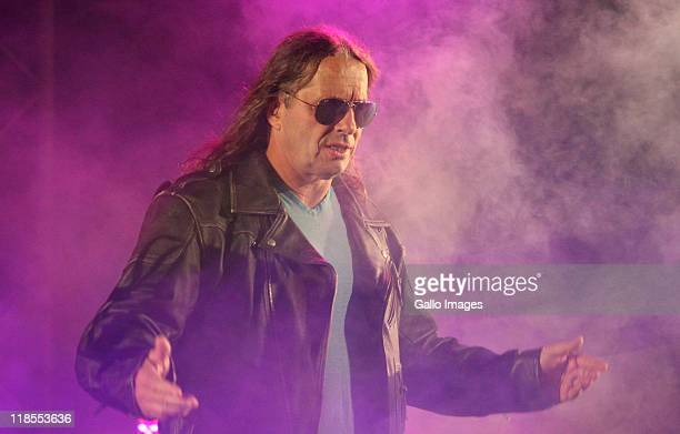 Special guest referee Bret 'The Hitman' Hart is introduced during the WWE Smackdown Live Tour at Westridge Park Tennis Stadium on July 08 2011 in...