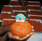 Special ladoos being made for Lalu Yadav and Nitish Kumar by the order of JDU leaders on the eve of Bihar elections on November 7 2015 in Patna India...