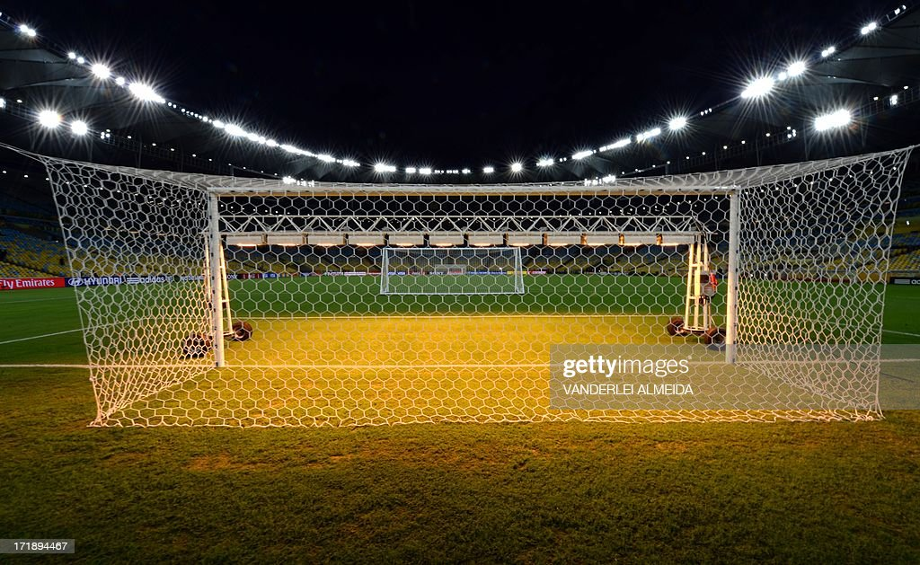 Special lights are installed to dry the pitch next to the goal post area inside the Maracana stadium in Rio de Janeiro, on June 29, 2013 during the Confederations Cup Brazil 2013 football tournament. Brazil and Spain will play the final of the competition on June 30 at Rio's Maracana Stadium.
