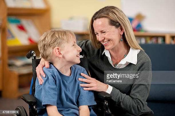 Special Needs Boy and Teacher