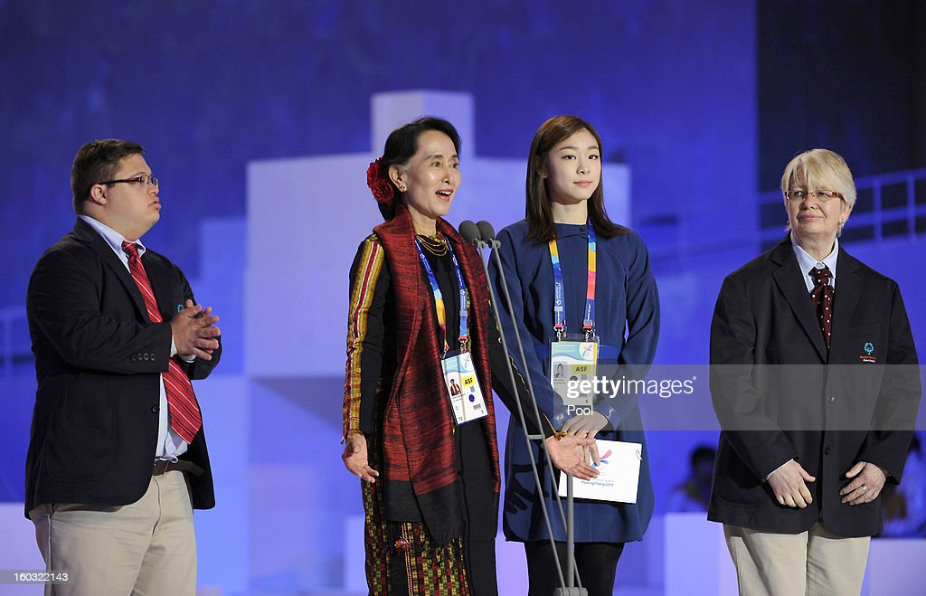 Special Olympics global messenger Ariel Ary of Costa Rica, Pro-democracy leader <a gi-track='captionPersonalityLinkClicked' href=/galleries/search?phrase=Aung+San+Suu+Kyi&family=editorial&specificpeople=214208 ng-click='$event.stopPropagation()'>Aung San Suu Kyi</a> and honorary ambassador Yuna Kim attend the Opening Ceremony of the 2013 Pyeongchang Special Olympics World Winter Games at the Yongpyeong stadium on January 29, 2013 in Pyeongchang-gun, South Korea.