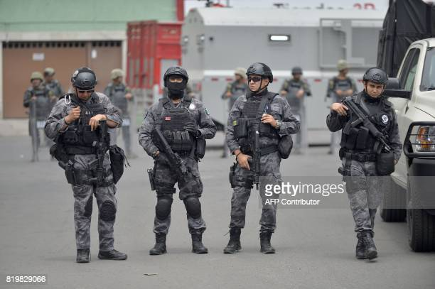 Special Operations Group officers mount guard in the scene of a shootout in which eight allegedly drug traffickers were shot dead by Mexican Navy...