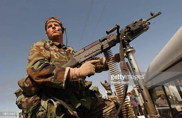 S special operations solder mans a machine gun April 10 2003 in the strategic northern Iraq oil city of Kirkuk Kurdish peshmerga guerrillas and US...