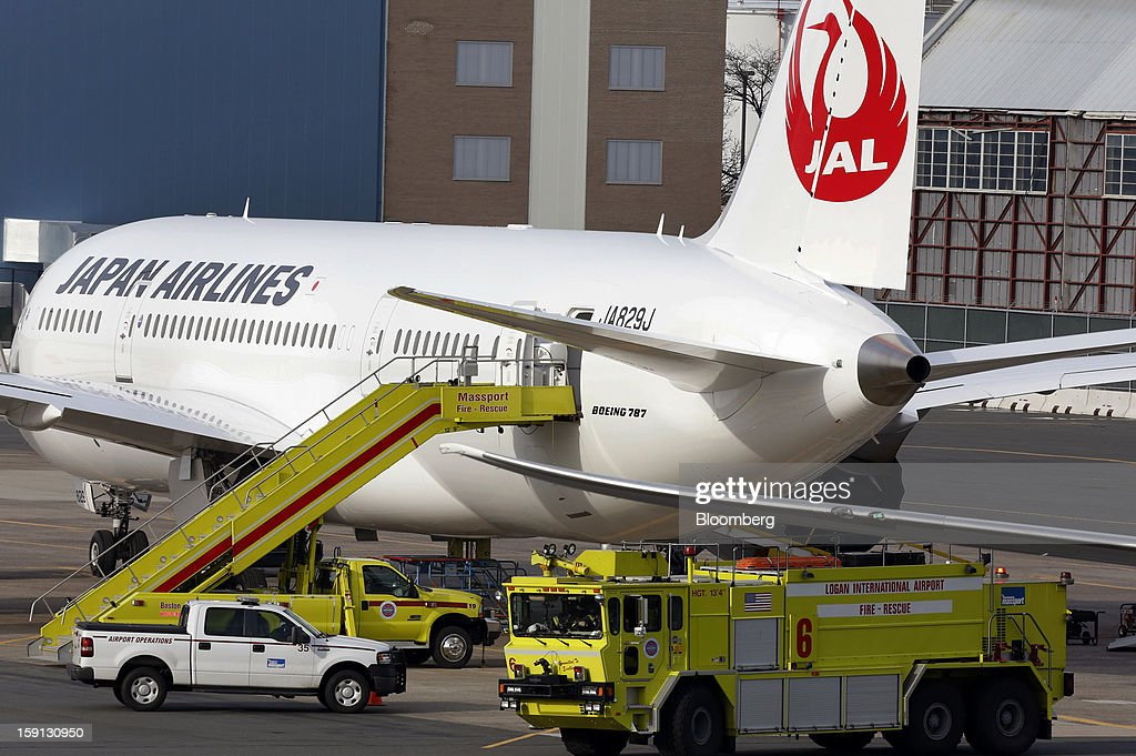 """Special operations vehicles surround a Boeing Co. 787 Dreamliner jet parked at a gate at Logan International Airport in Boston, Massachusetts, U.S., on Tuesday, Jan. 8, 2013. A fire aboard the Boeing Co. 787 Dreamliner in Boston yesterday caused """"severe damage"""" to a battery unit, U.S. investigators said today. Photographer: Bizuayehu Tesfaye/Bloomberg via Getty Images"""