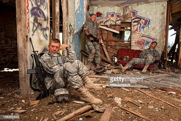 Special ops military soldier resting in an abandoned house