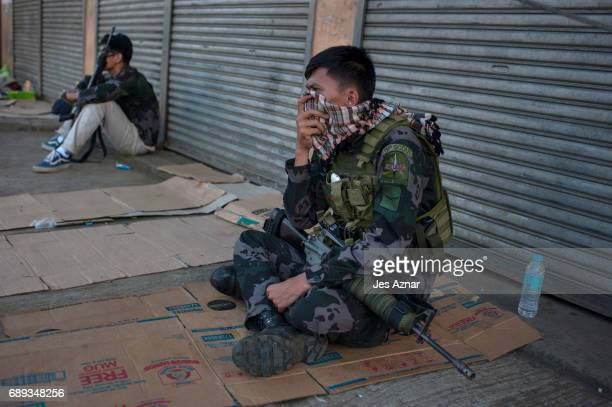 Special ops police rest while securing a street on May 28 2017 in Marawi city southern Philippines Filipino authorities announced on Sunday that the...
