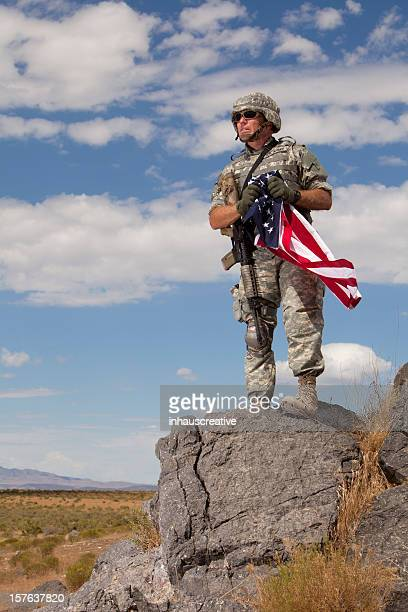 Special Ops Soldier holding an American Flag