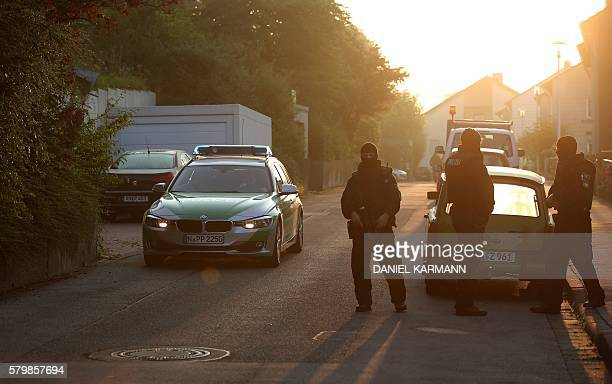 Special police forces block the street near a refugee shelter where a 27yearold Syrian migrant who set off an explosive device near an openair music...