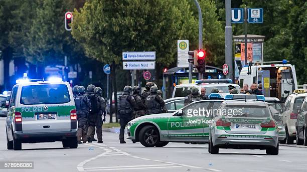 Special police forces prepare to enter the shopping center as they respond after a shooting at the Olympia Einkaufzentrum at July 22 2016 in Munich...