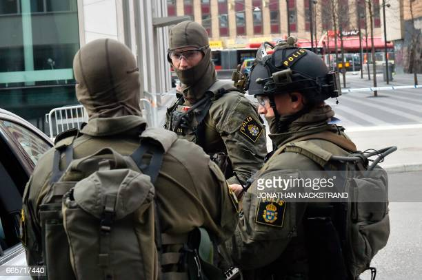 Special Police forces work at the scene where a truck crashed into the Ahlens department store at Drottninggatan in central Stockholm April 7 2017...