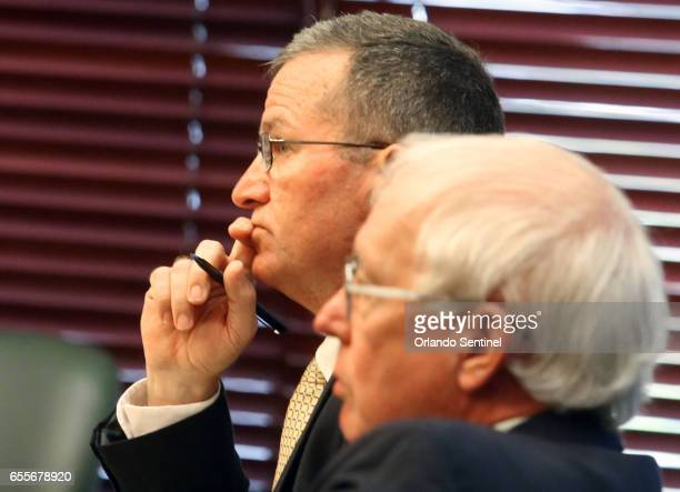 Special prosecutor Brad King left listens Monday March 20 2017 to State Attorney Aramis Ayala asking for Markeith Loyd's case to pause while she...
