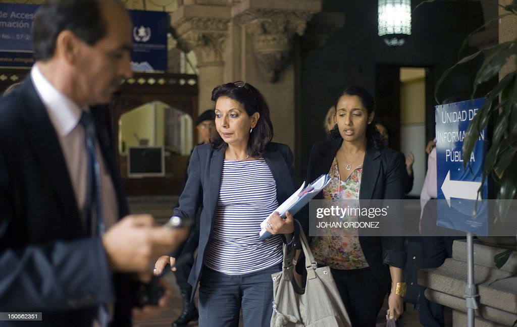 UN Special Rapporteur on the sale of children, child prostitution and child pornography, Najat Maalla M'jid (C), leaves after a private meeting with Guatemalan Interior Minister, Mauricio Lopez (out of frame), on August 21, 2012 in Guatemala City. AFP PHOTO / Johan ORDONEZ