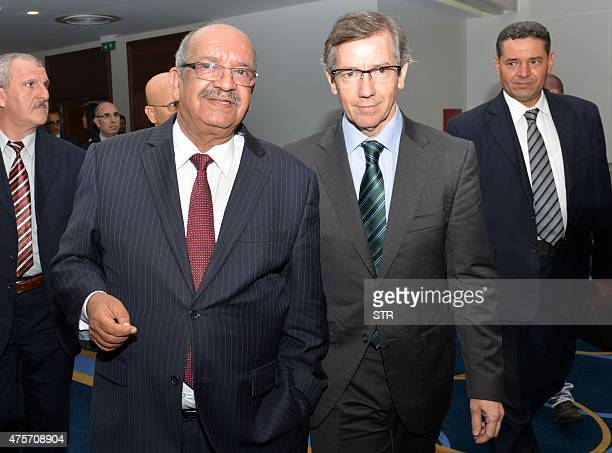 Special Representative and Head of the United Nations Support Mission in Libya Bernardino Leon walks with Algerian Minister for Africa and Maghreb...