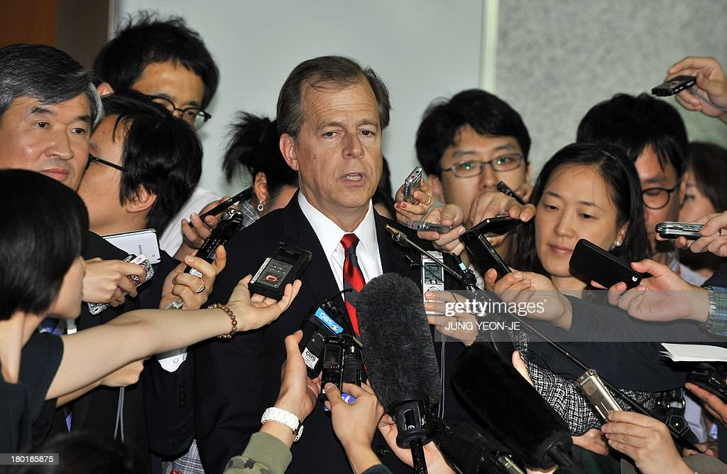 US Special Representative for North Korea Policy Glyn Davies (C) speaks to the media as his South Korean counterpart Cho Tae-Yong (L) listens to after their meeting on North Korea's nuclear programme at the foreign ministry in Seoul on September 10, 2013.
