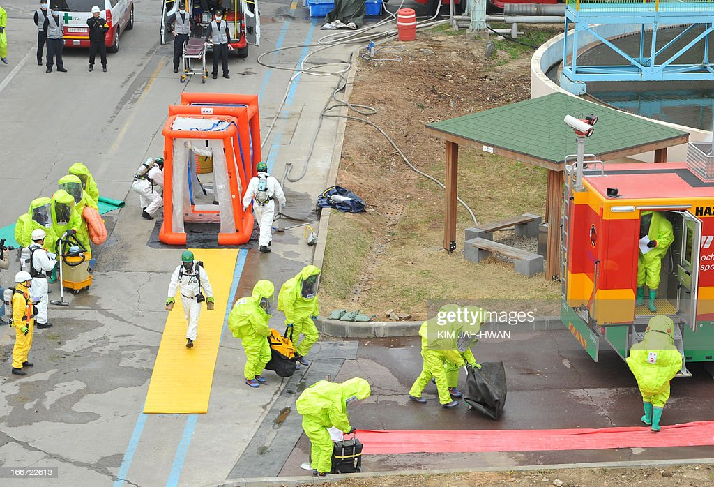 A special team of South Korean firefighters stage a drill for disasters such as toxic chemical leakage in a power plant in Seoul on April 16, 2013. The drill comes after North Korea vowed retaliation over an anti-Pyongyang rally in which South Korean activists burnt effigies of the North's revered leaders.