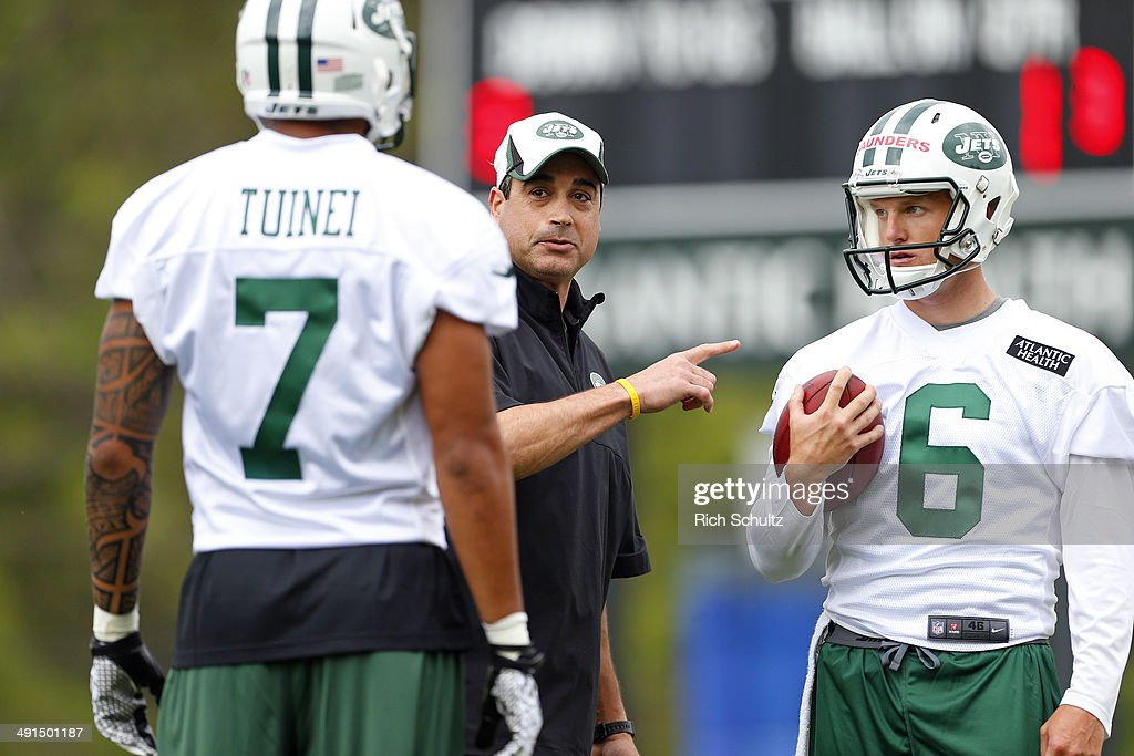 Special teams coach Louie Aguiar, center, talks with Wide Receiver Lavasier Tuinei #7 and Punter Brian Saunders #6 during the first day of rookie minicamp on May 16, 2014 in Florham Park, New Jersey.