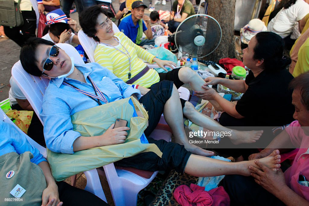 Special tent tent set up with volunteer massagers massaging the feet and shoulders of weary protestors for free Thai Prime Minister Yingluck...