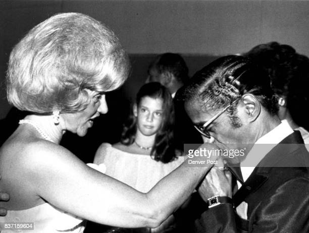 Special to Los Angeles Times Mrs Marvin Davis and Sammy Davis Jr in this Denver Post file photo Dana Davis is in background 1981