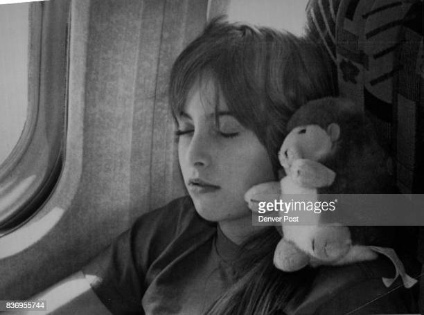 Special to the Denver Post 12286 Tenyearold Bobbi Winterowd napped with a stuffed animal on her shoulder on the pane trip to Orlando Florida...