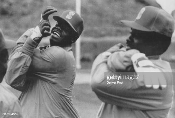 Bill O' Connell Ken Griffey Jr wears a big gin in this March 1 file photograph as he and his father Ken Sr exercise in the rain at Seattle Mariners...