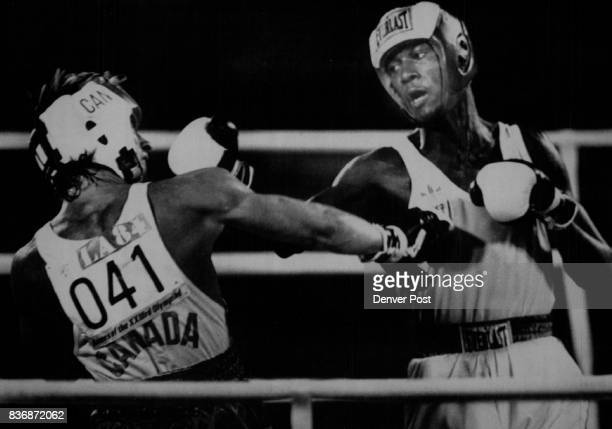 Special to the Denver Post Mark Breland slams a right to Wayne Gordon in their preliminary bout at 67kg which Breland won DP/Strohmeyer AttnTed...