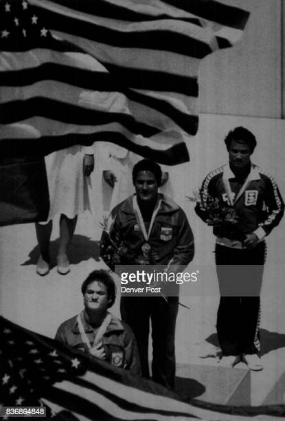 Special to the Denver Post USA's Bruce Kimball silver medalist Greg Louganis gold and Kongzhen Li China won the bronze in mens platform diving finals...