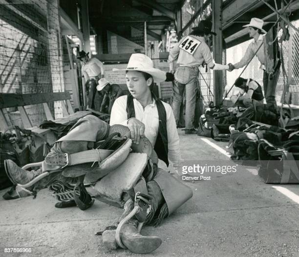 Special Transmission For The Denver Post Lawrence Bishop a Middleton Ohio cowboy resins his saddle while warming up on the floor of the 'ready' area...