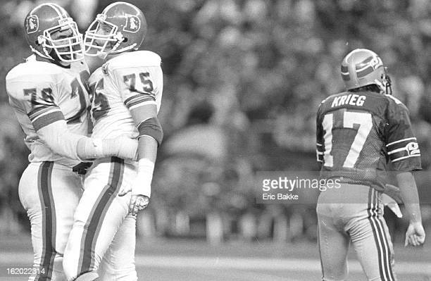 JAN 2 1985 Special Transmission to the Denver Post Barney Chayous and Rulon Jones exchange hugs after their 2nd half sack of Dave Krei getting up in...