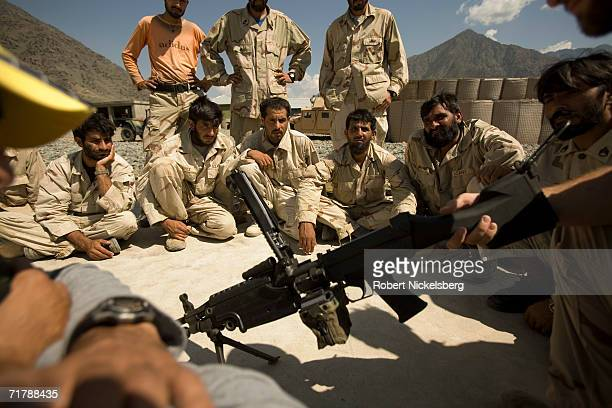 Special US government instructors from Operational Detachment Alpha right train soldiers from the Afghan Security Guard at a Forward Operation Base...