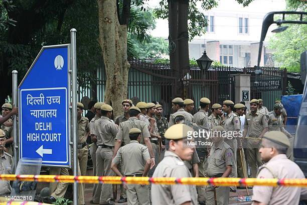 Special Weapons And Tactics members from the Delhi police keep vigil after cordoning off the site of a bomb blast outside the High Court in New Delhi...