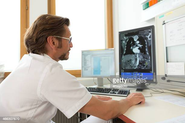 specialist analyzing x-ray on screen