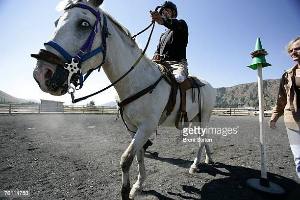 Specialist Andrew W Soule takes his horse through a series of poles in an arena August 14 2006 in Sun Valley Idaho He is learning how to ride...