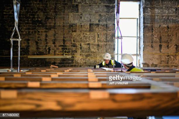 Specialist carpenters from Lawrence McIntosh install the floor to the bookstore above the Mackintosh Library on November 22 2017 in Glasgow...