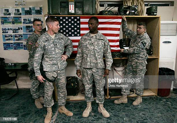 Specialist Charles Jones of Wilmington Delaware is sworn in by Lt Col Steve Miska at an impromptu reenlisting ceremony February 14 2008 at Forward...