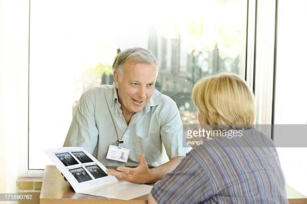 Specialist doctor explains scans to woman