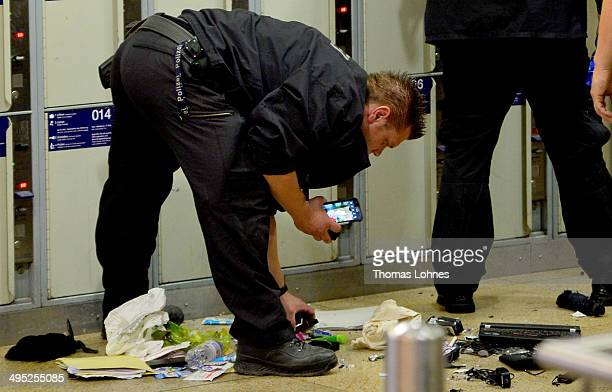Specialist of the Ferderal Police examine two bags suspect with exploxive substance in front of the lockers at the main railway station on May 27...