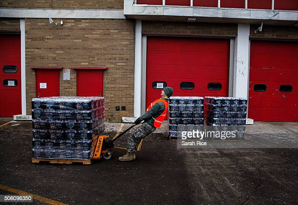 Specialist Philip Jerashen pulls a pallet of water at Fire Station one of the locations residents can come to get clean water on January 21 2016 in...