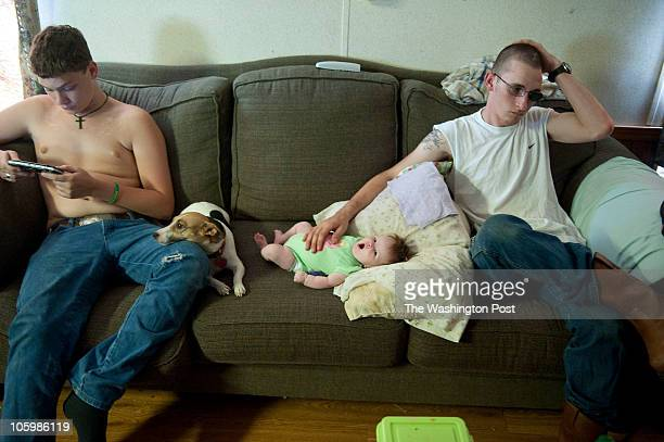 Specialist Robert Lewis Warren his brother Chris Bryant 15 and his infant daughter Adrianne relaxing on an afternoon at his mother's home Specialist...
