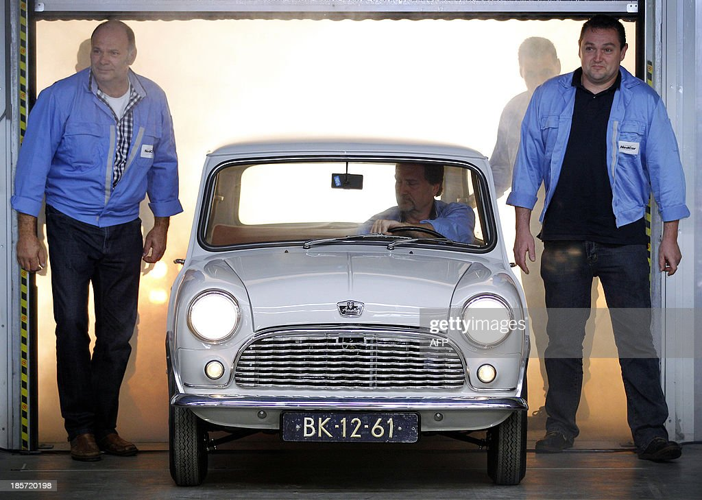 Specialists from VDL Nedcar present an authentic classic Mini at a plant in Born on October 24, 2013. Specialists from VDL Nedcar have restored the Austen Seven from 1959 and the car is one of the oldest of this type in the world. The car manufacturing plant will produce certain Mini models in the Limburg factory from 2014 onwards.