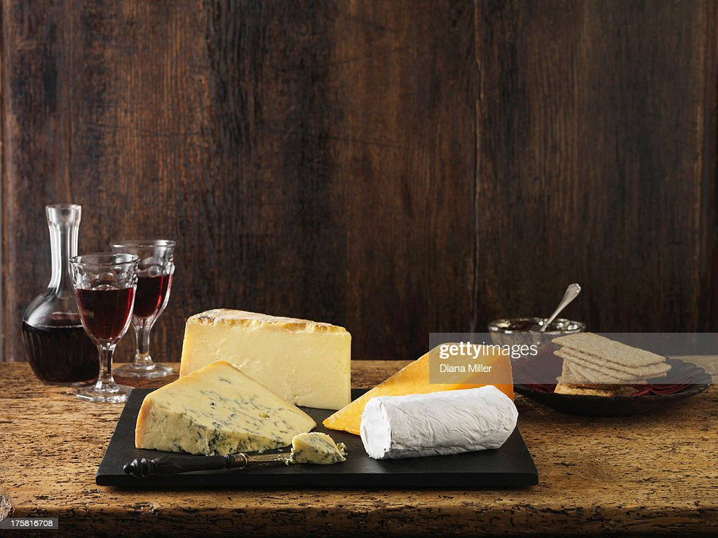 Speciality Christmas cheeseboard selection. Stilton, goats cheese, red leicester and cheddar with red wine and crackers