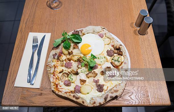 A specially created pizza for the EURO 2016 called 'Zlatan' refering to Swedish footballer Zlatan Ibrahimovic is pictured in a local pizzeria in...