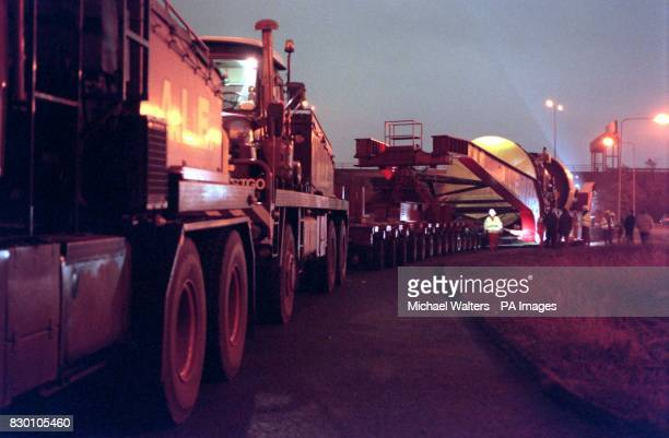 A specially designed lorry moving at 4mph carries a massive gas turbine on the M25 to a power station which is being built in Enfield The lorry's...