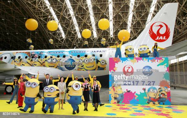 A specially painted aircraft JAL MINION JET featuring a character from the popular animated film 'Minions' is unveiled by Japan Airlines Co at Osaka...