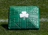 Specially painted green bases were used during the spring training game between the Boston Red Sox and the Baltimore Orioles in honor of St Patrick's...