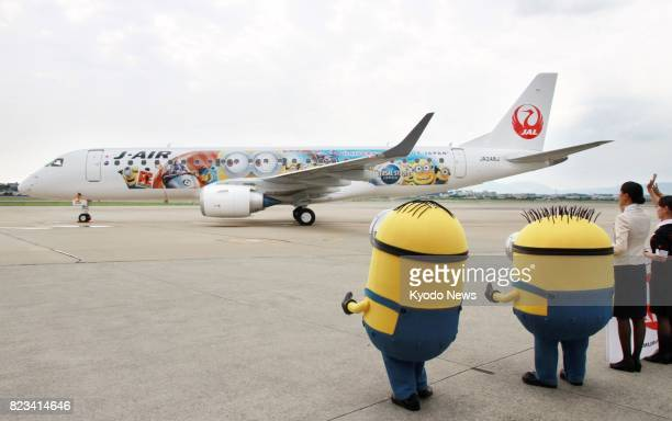 A specially painted Japan Airlines Co JAL MINION JET promoting a collaboration with Universal Studios Japan and adorned with a character from the...