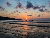 spectacular bali sunset at jimbaran beach, tropical indonesia, island surfer paradise