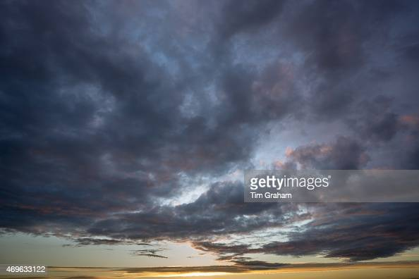 Spectacular sinister puffy clouds in dramatic moody sky in evening sunset in the UK