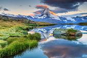 Stunning panorama with Matterhorn at morning sunrise and beautiful alpine lake,Stellisee,Valais region,Switzerland,Europe